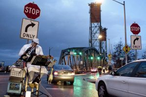 Kirk Reeves playing a trumpet on Hawthorn Bridge.