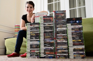 """Anita Sarkeesian + Research Materials"" by Anita Sarkesian is licensed under CC BY-NC-ND 2.0."
